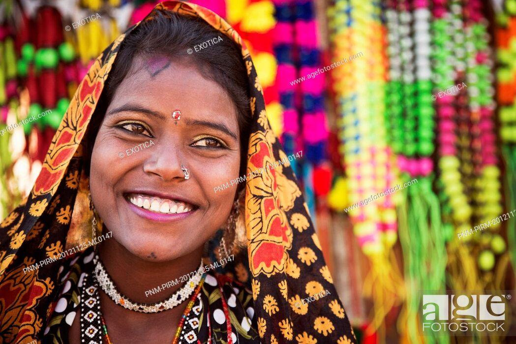 Stock Photo: Woman posing in traditional Rajasthani dress, Pushkar, Ajmer, Rajasthan, India.