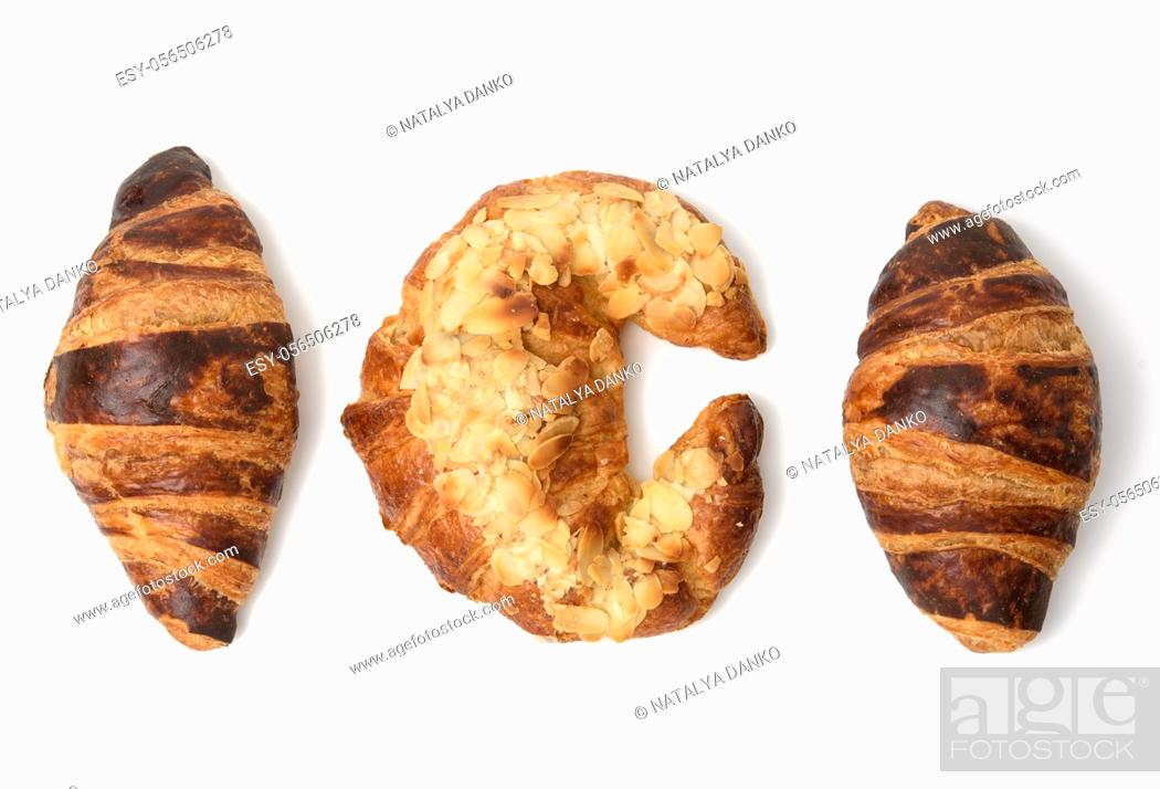 Stock Photo: baked croissant sprinkled with almonds, dessert on white background, top view.