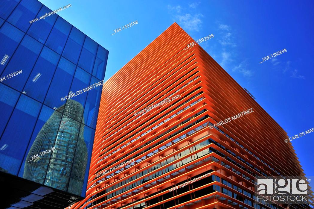 Stock Photo: Bassat Ogilvy group headquarters (left, PBA y BG Arquitectura), CMT (Comisión del Mercado de las Telecomunicaciones, Spanish communications industry regulator).