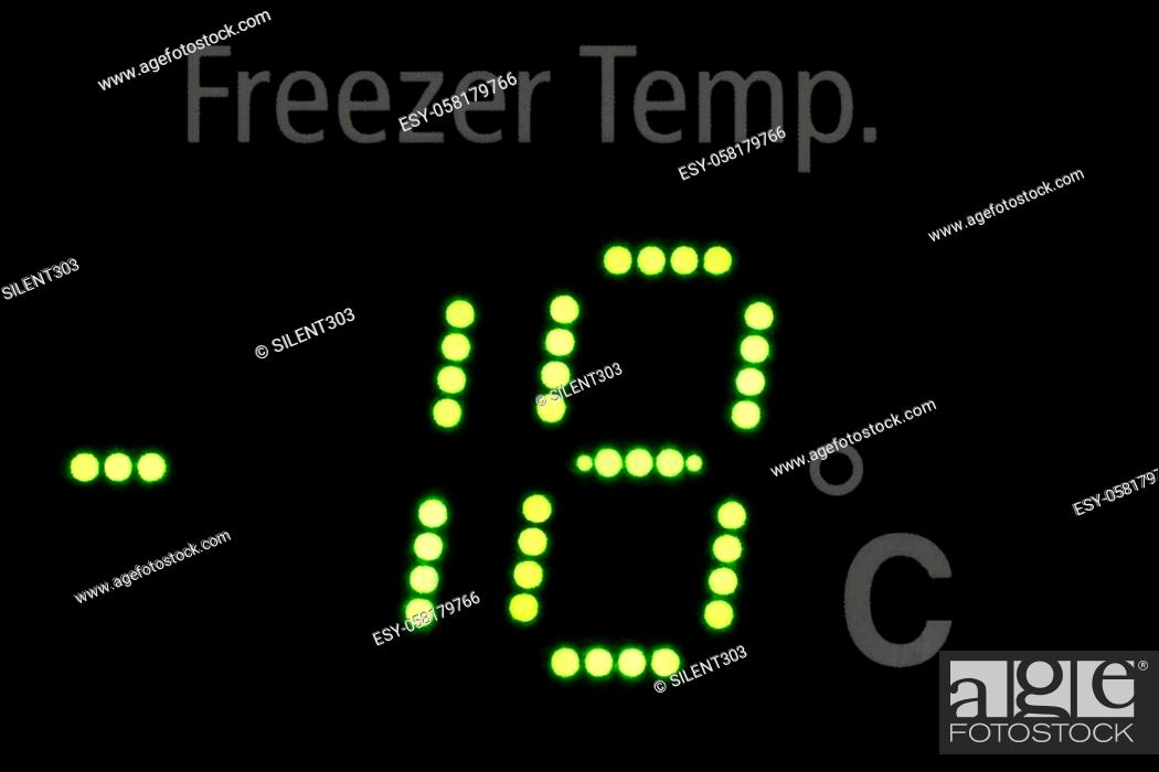 Stock Photo: Close up of a freeze indicator showing -18 degrees in green led letters.