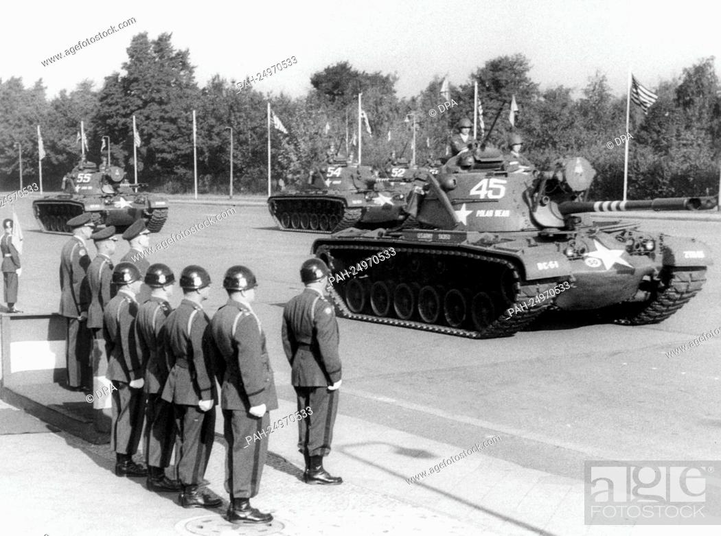 Stock Photo: Tanks of the US Army driving past the VIP stand with the commanding generals on occasion of a military parade of the US troops for the 11th anniversary of their.
