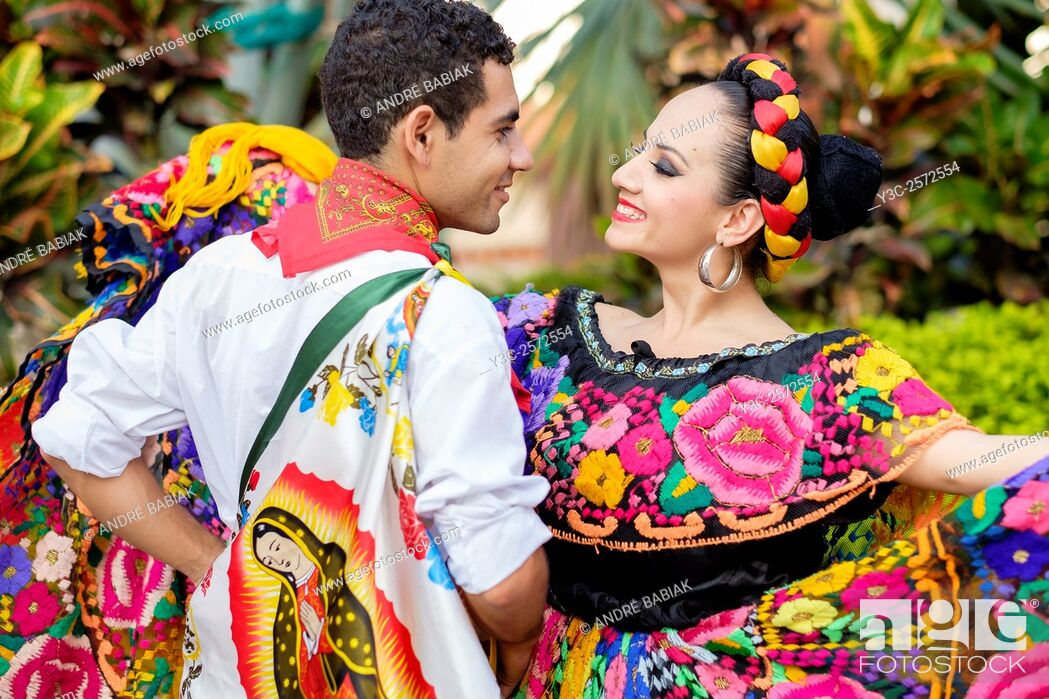 Stock Photo: Colorful Mexican costumes - Puerto Vallarta, Jalisco, Mexico. Xiutla Dancers - a folkloristic Mexican dance group in traditional costumes representing the.