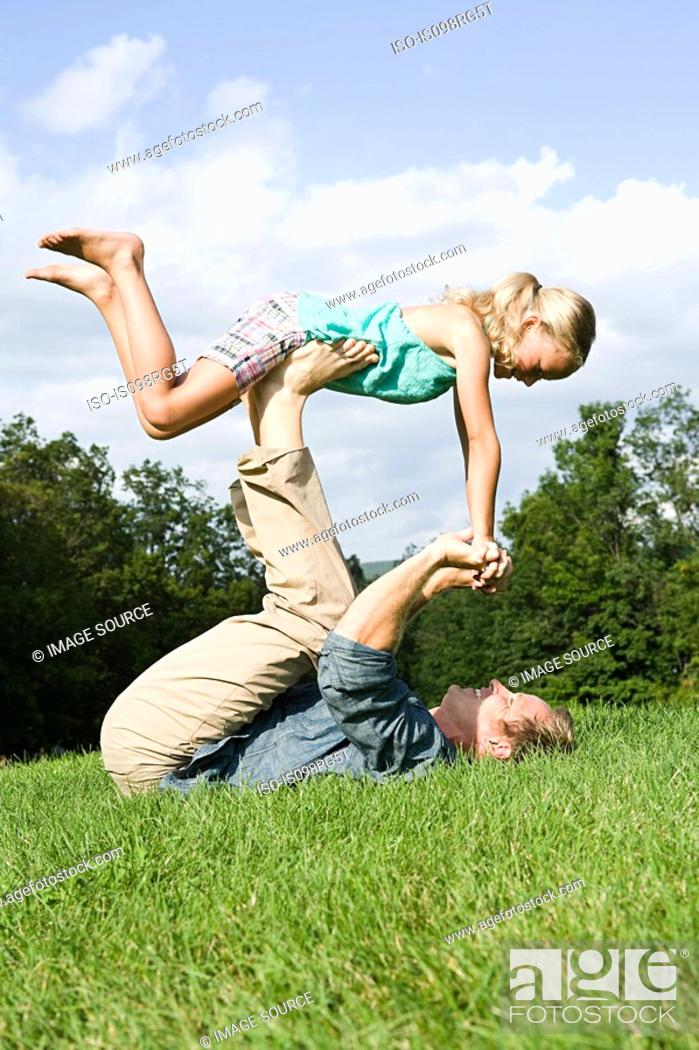 Stock Photo: Father and daughter playing in park.