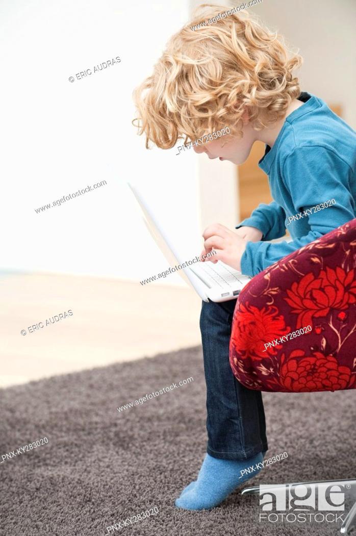 Stock Photo: Boy using a laptop.