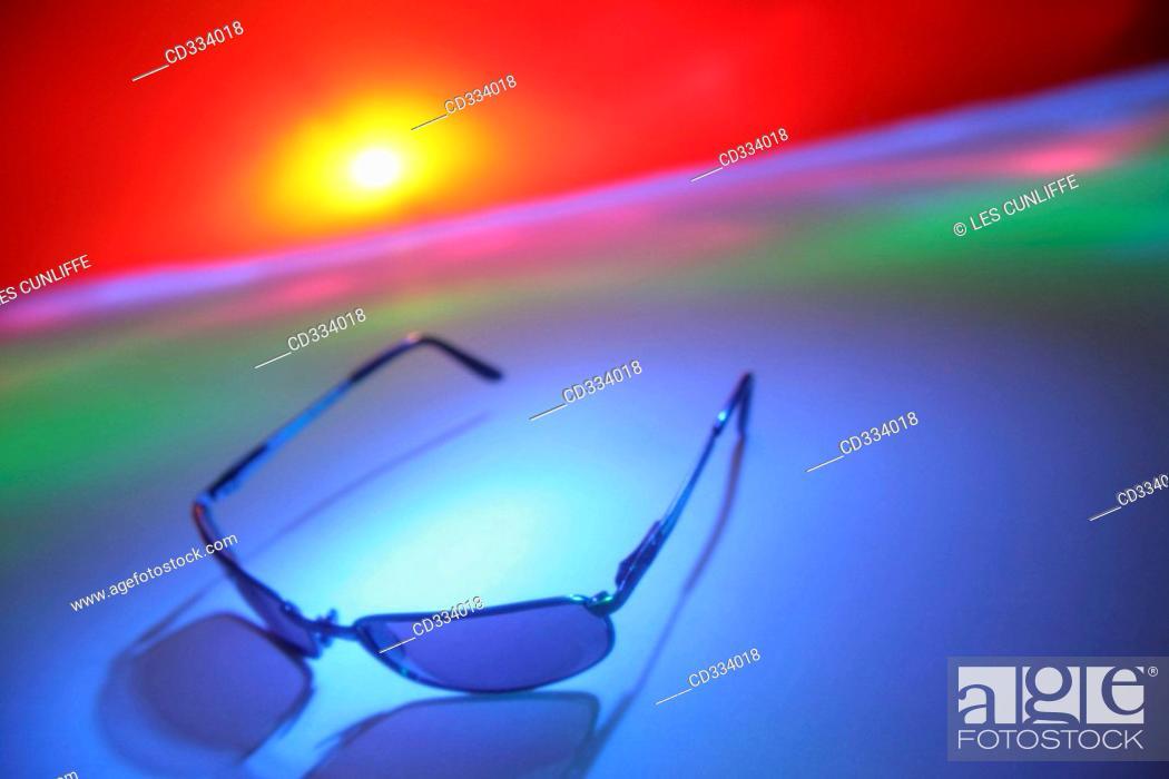 Stock Photo: Sunglasses. Sunrise.