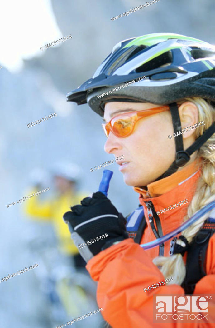 Stock Photo: Side view of female cyclist.