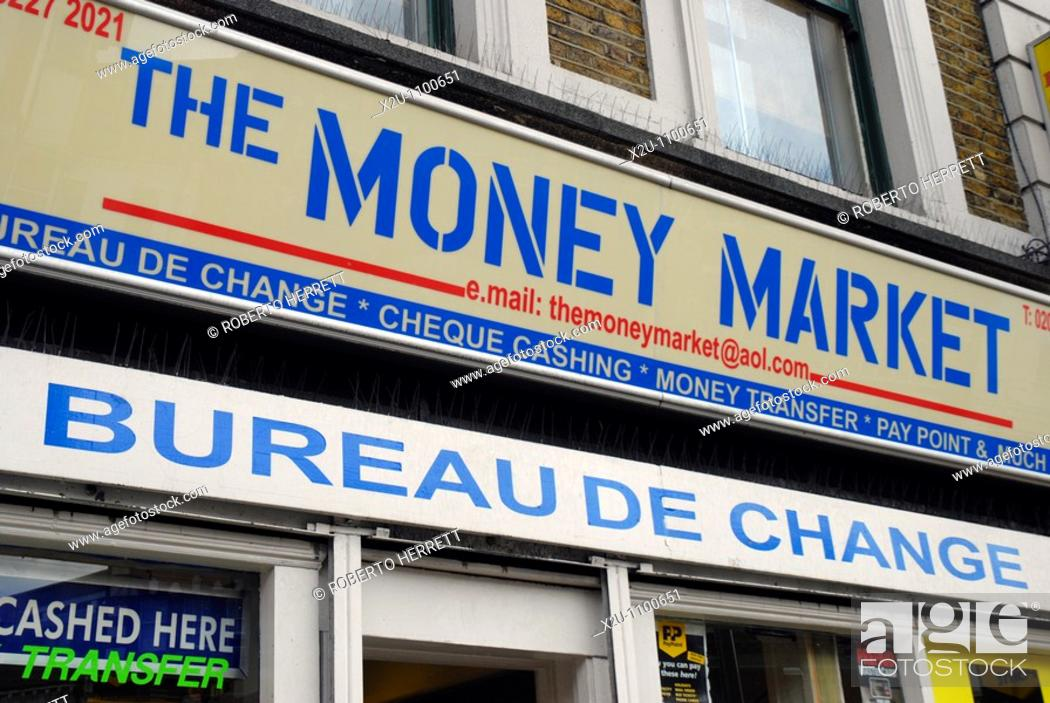 Money market sign on exterior of uk bureau de change stock