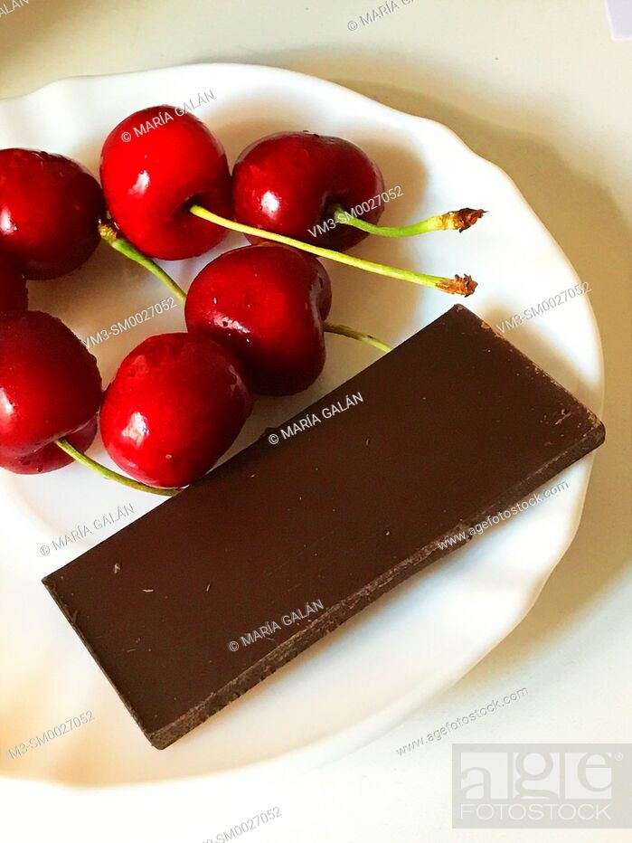 Stock Photo: Chocolate and cherries.