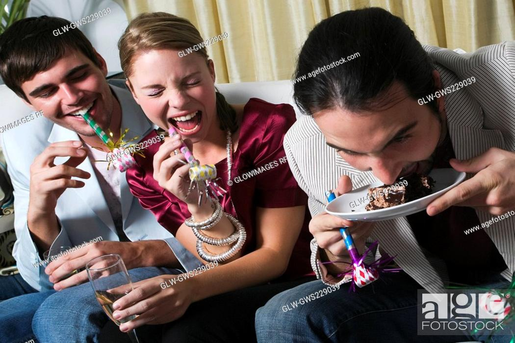 Stock Photo: Young man with his friends enjoying a birthday party.