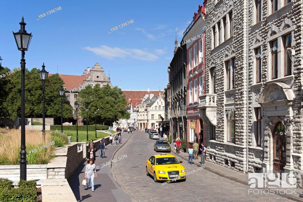 Stock Photo: Yellow Taxi in Old Tallinn, Estonia.