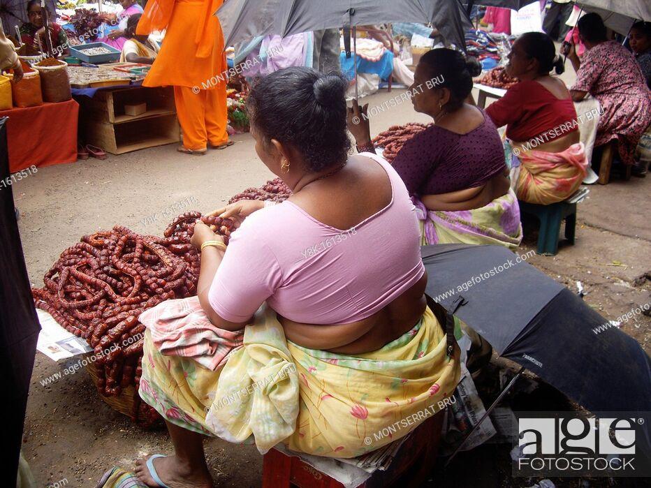 Stock Photo: Chourisso saleswomen stalls at Mapusa market, Goa, India.