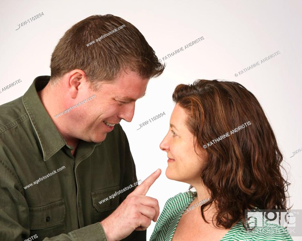 Stock Photo: Flirtatious heterosexual couple.