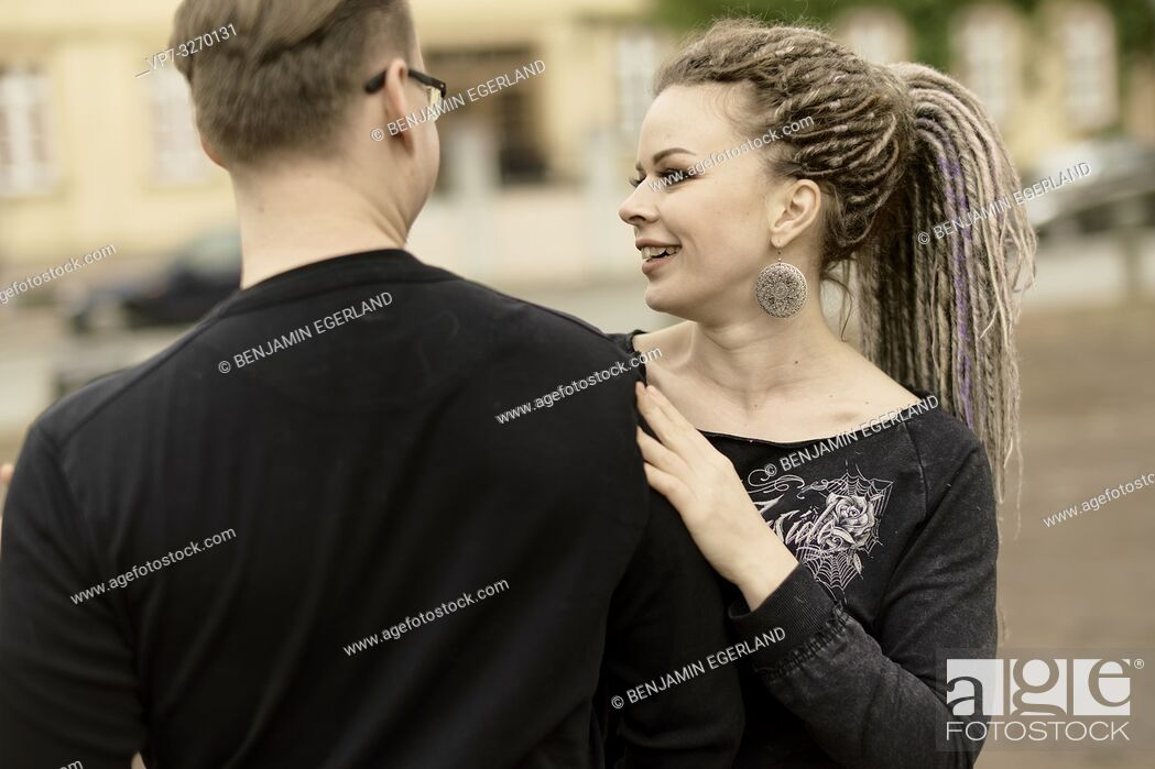 Imagen: woman teaching man how to dance, guiding his shoulder, couple, in Cottbus, Brandenburg, Germany.