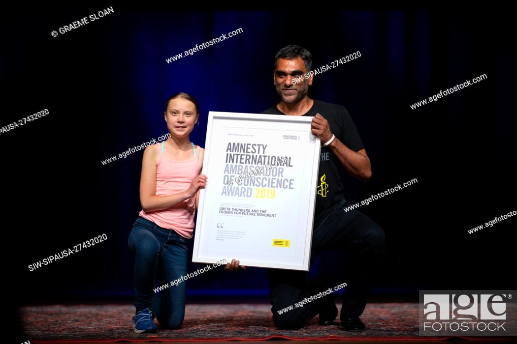 Stock Photo: Environmental Activist Greta Thunberg accepting the Amnesty International Ambassador of Conscience award from Secretary General Kumi Naidoo on September 16.