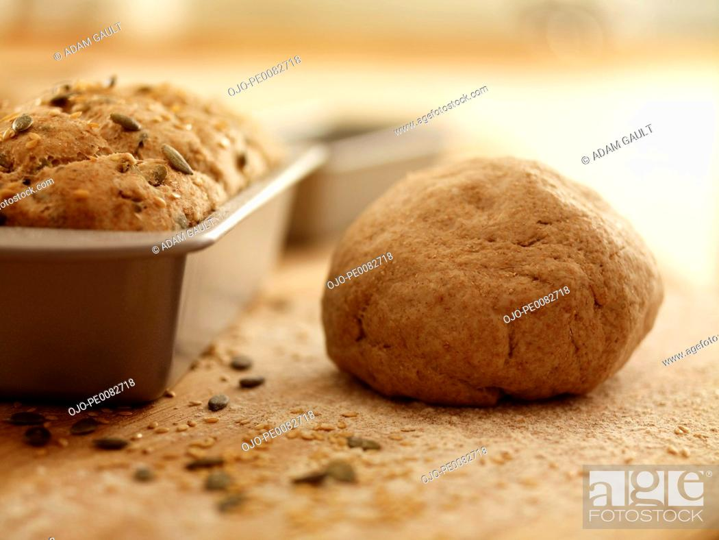 Stock Photo: Close up of fresh baked bread and dough.