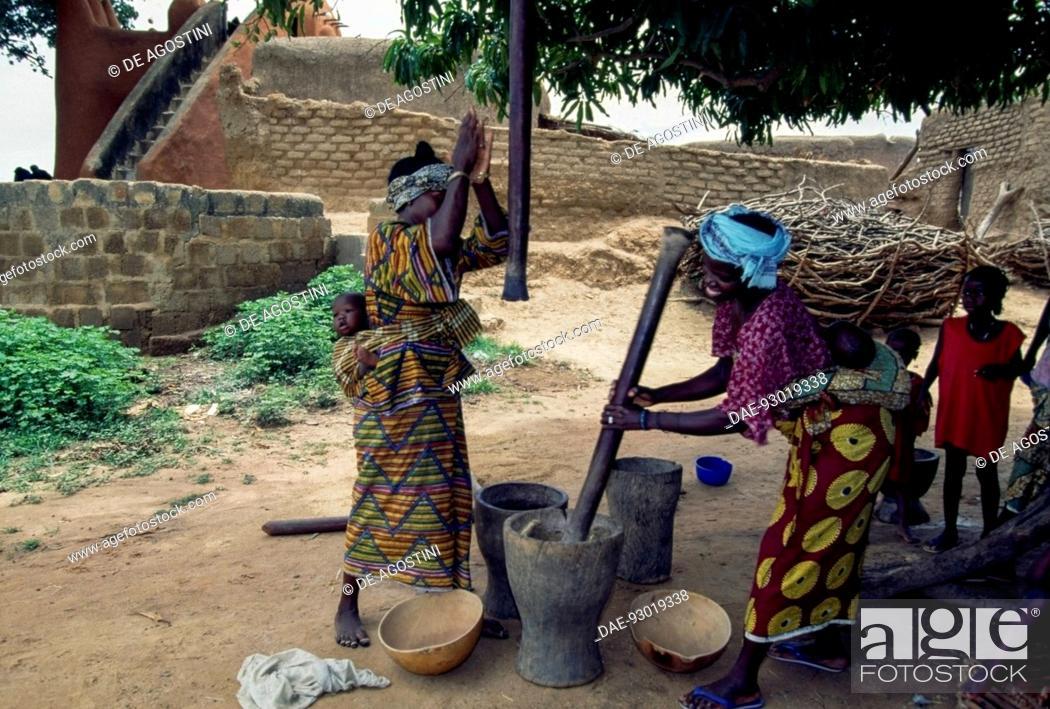 Stock Photo: Women working millet in the Bambara village of Segoukoro, near Segou, Mali.