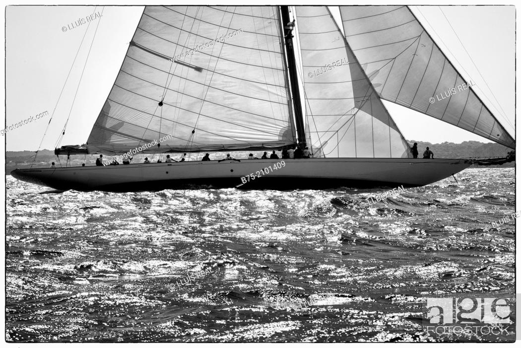 Stock Photo: Classic sailboat in a regatta with sailors in the background at the Port Mahon, Menorca, Balearic Islands, Spain.