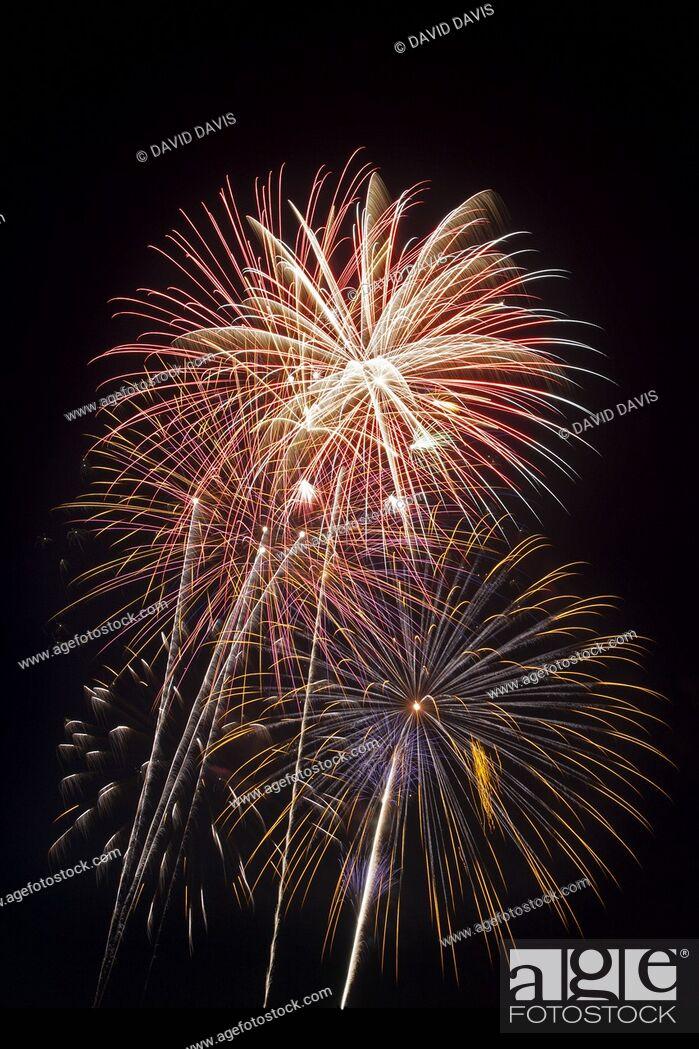 Stock Photo: Beautiful fireworks display fills the night time sky.