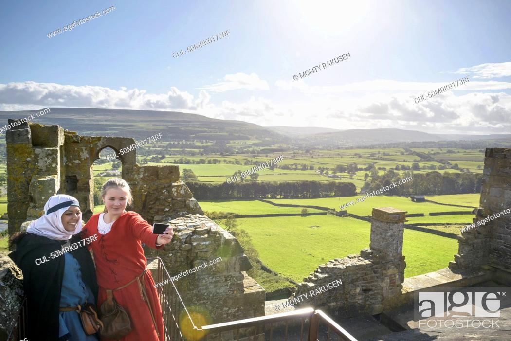 Stock Photo: Students in period dress at castle.