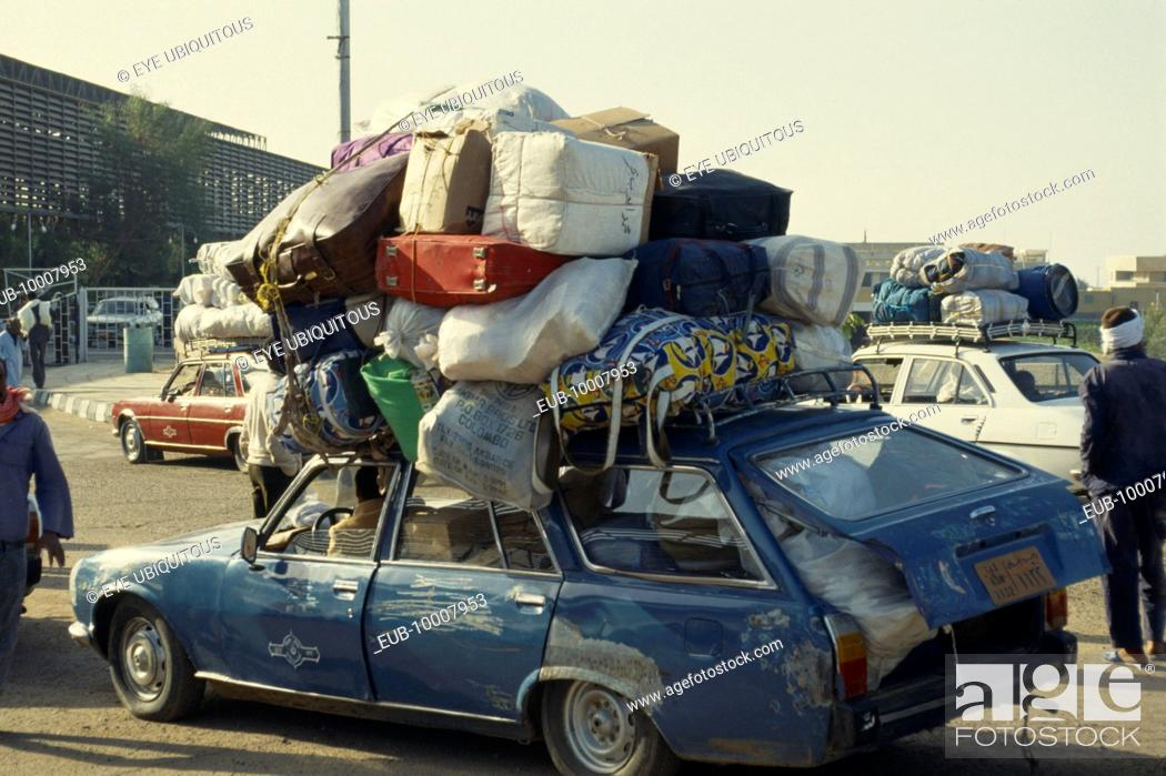Stock Photo: Sudanese family in overloaded car waiting for ferry to Sudan.
