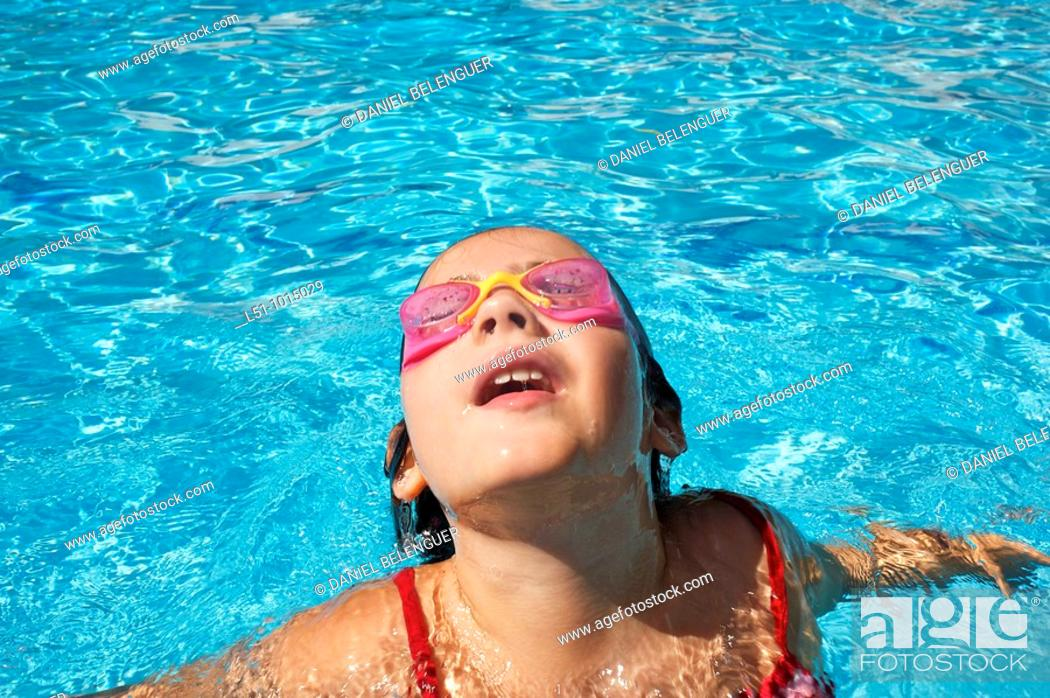 Stock Photo: Girl with goggles on a swimming pool in Ludiente, Castellón.