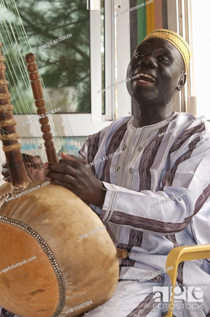 Stock Photo: Senegalese musician playing kora.