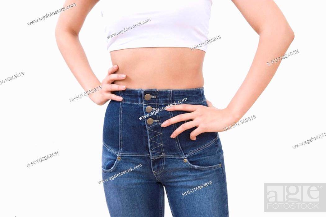 Stock Photo: Woman wearing jeans, front view.