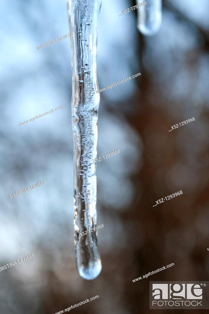 Stock Photo: An icicle full of trapped air bubbles.