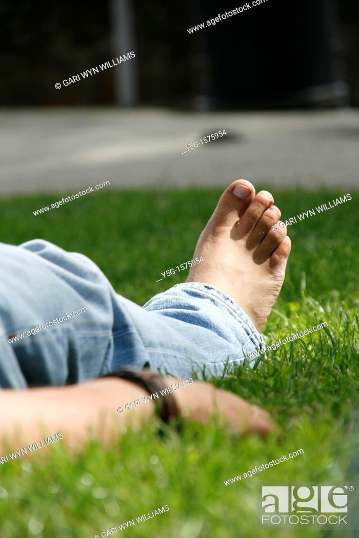 Stock Photo: one man sleeping on lawn grass in park.