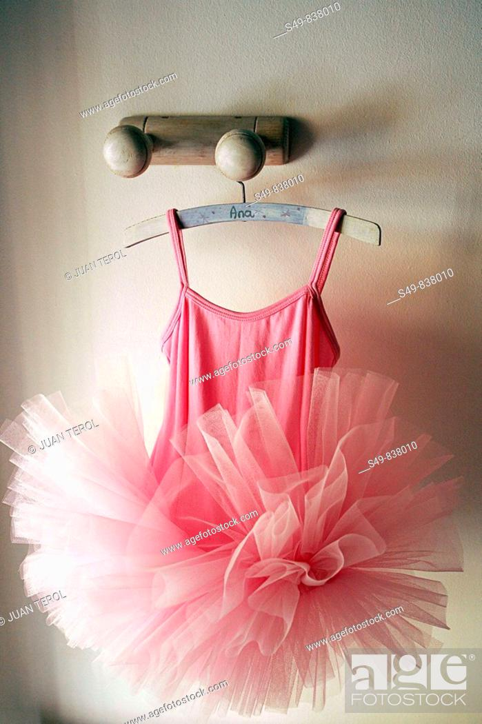 Stock Photo: ballerina dress hanging from a perch.