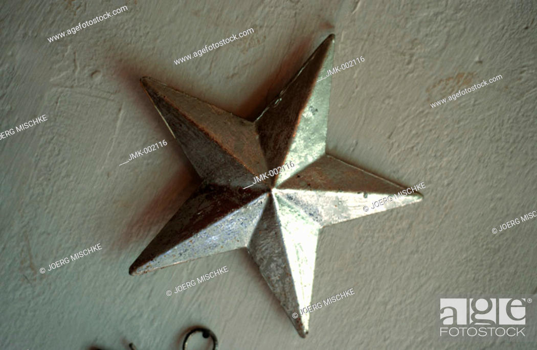 Stock Photo: A silver decoration star at a window.