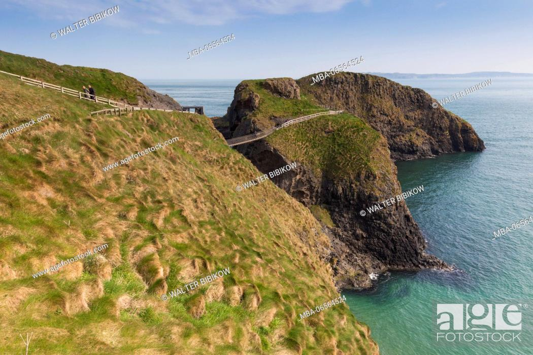 Stock Photo: UK, Northern Ireland, County Antrim, Ballintoy, Carrick-a-Rede Rope Bridge, elevated view.