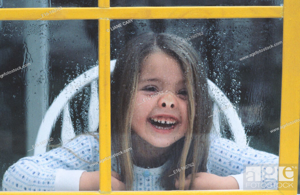 Stock Photo: Girl behind yellow window.