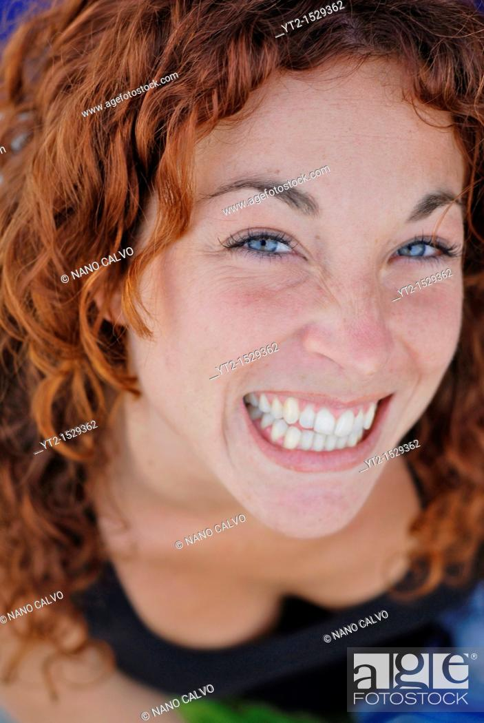 Stock Photo: Portrait of a cute red haired girl in her twenties, relaxing in Ibiza, Spain.