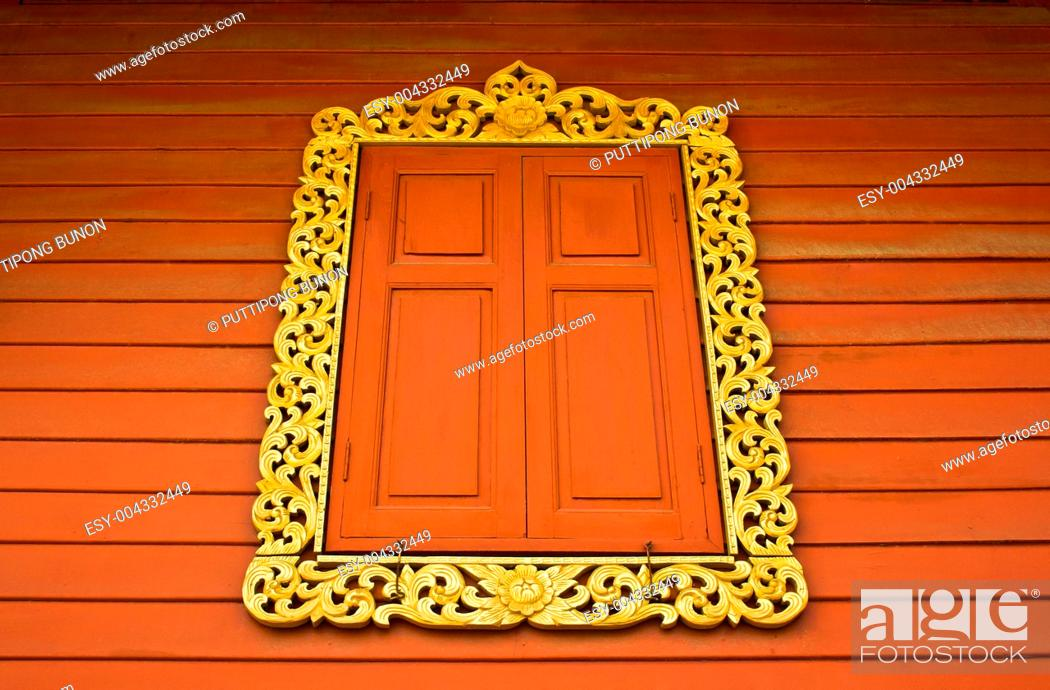 Stock Photo: Ancient Golden carving wooden window of Thai temple in Bangkok, Thailand.