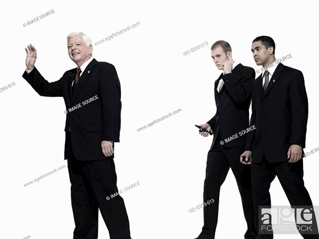 Stock Photo: Politician and bodyguards.