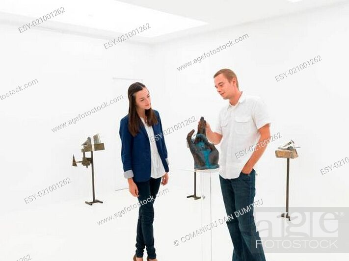 Stock Photo: friends visiting art exhibition.