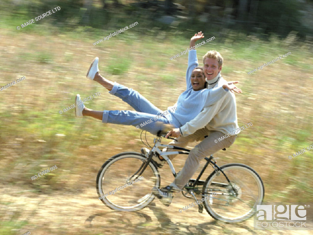 Stock Photo: Couple cycling.