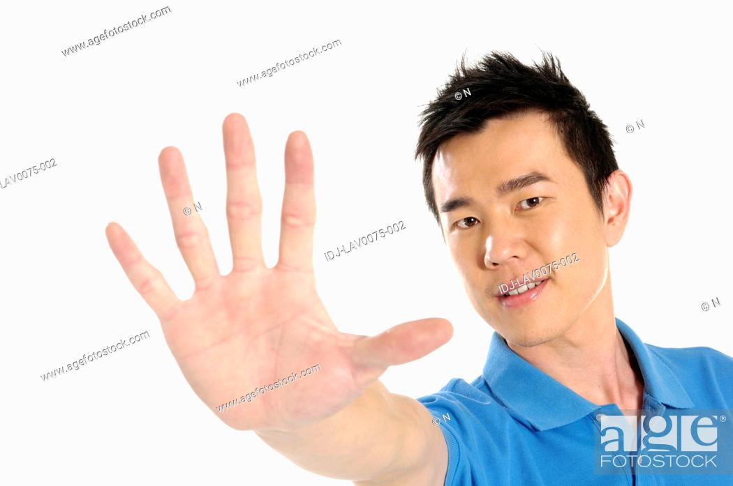 Stock Photo: Male university student showing stop gesture.