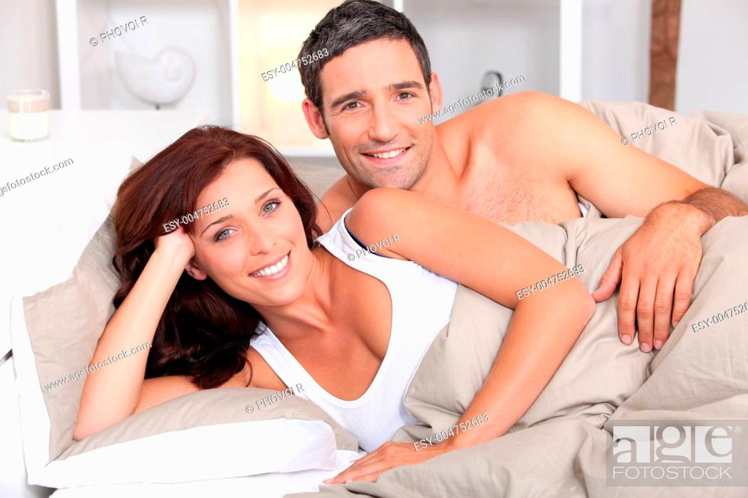 Stock Photo: a couple reposing in bed in the morning.