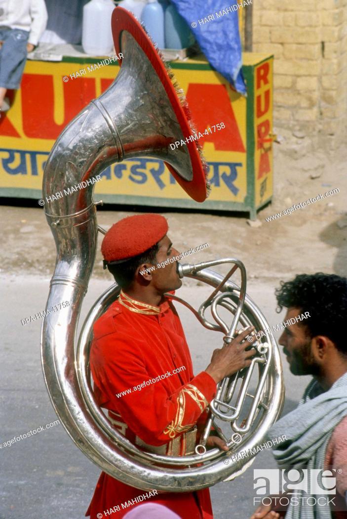 Stock Photo: Man playing Tuba kumbh fair ; haridwar ; uttar pradesh ; india.