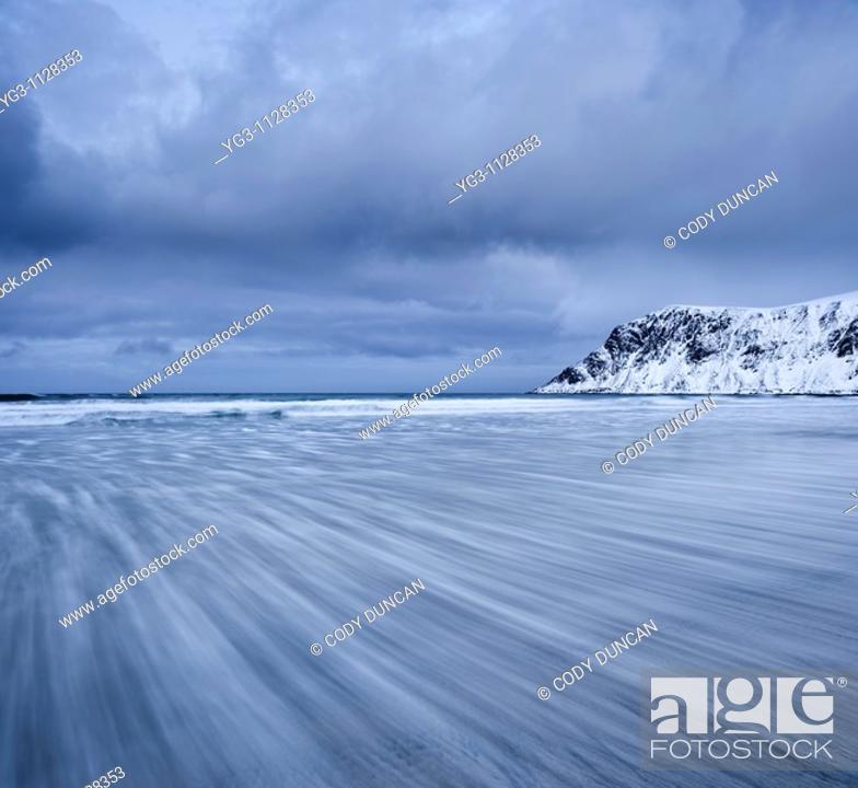 Stock Photo: waves move across Skagsanden Beach, Flakstad, Flakstadøy, Lofoten islands, Norway.