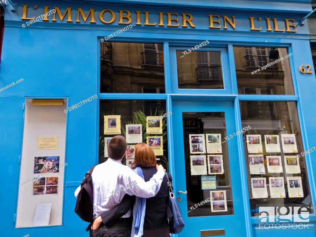 Stock Photo: Paris, France, Couple Window Shopping at Real Estate Agent, in the Ile Saint Louis.