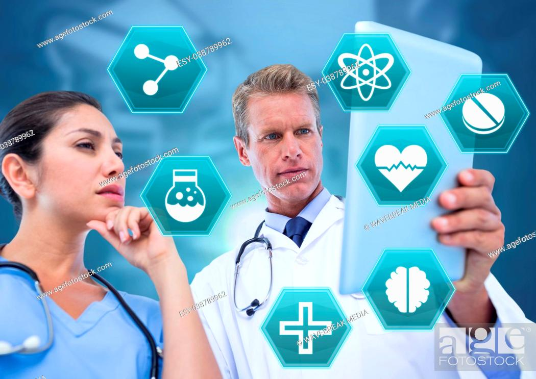 Stock Photo: Doctor's holding tablet with medical interface hexagon icons.