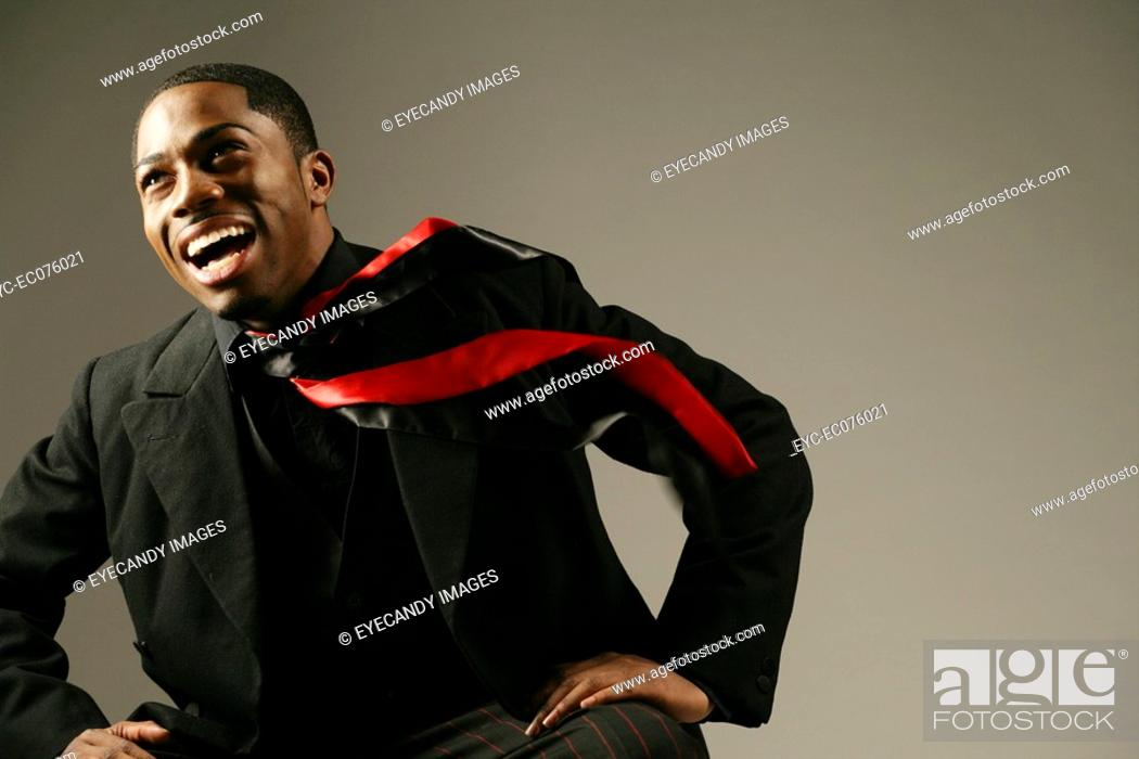 Stock Photo: Young happy African American man, studio shot.