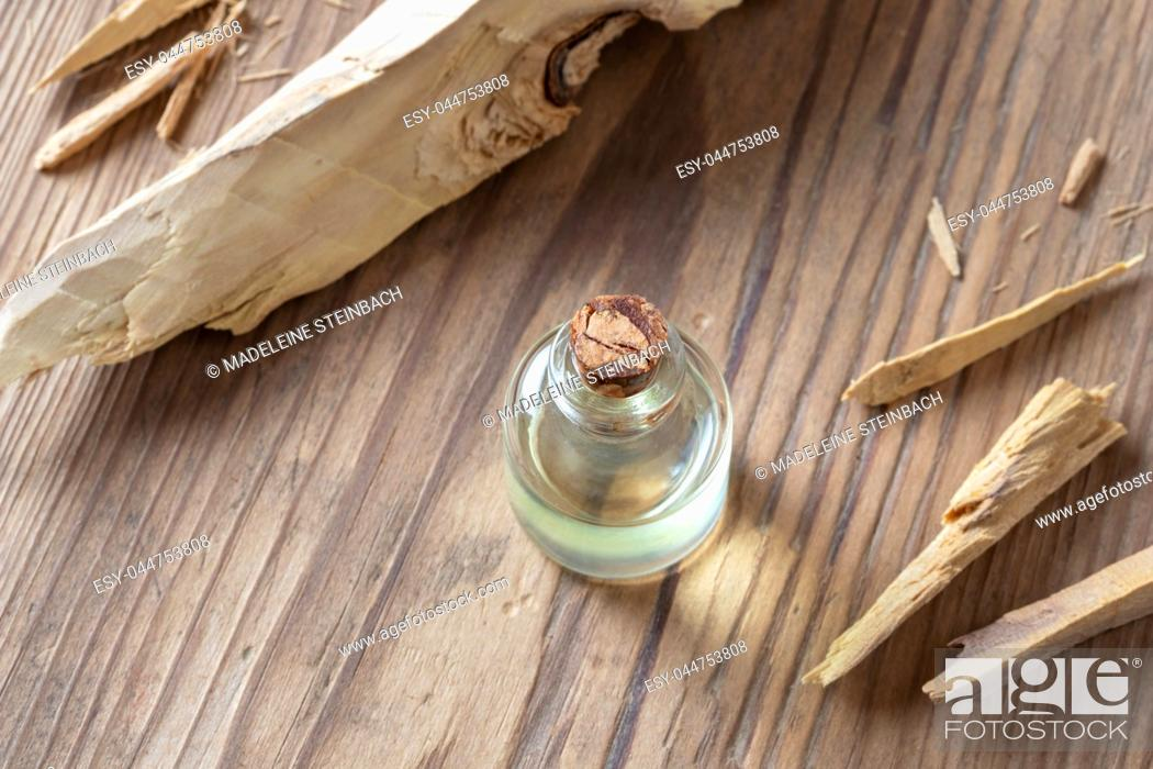 Stock Photo: A bottle of essential oil with white sandalwood.