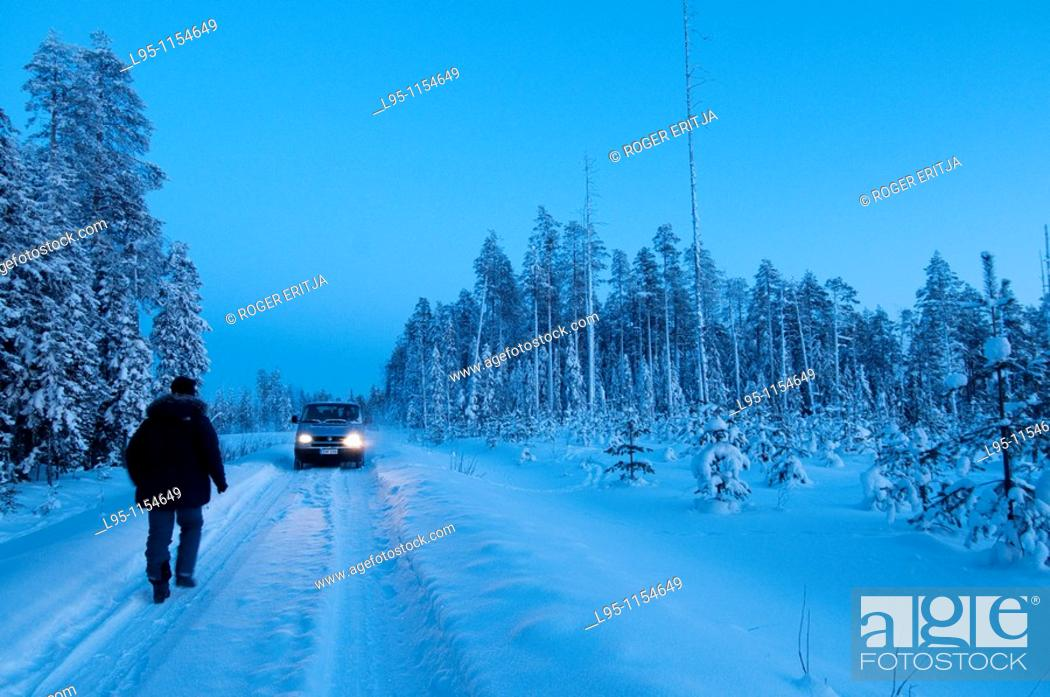 Stock Photo: Van car crossing Taiga forest, Kuhmo, Finland, near the Russian border in February.