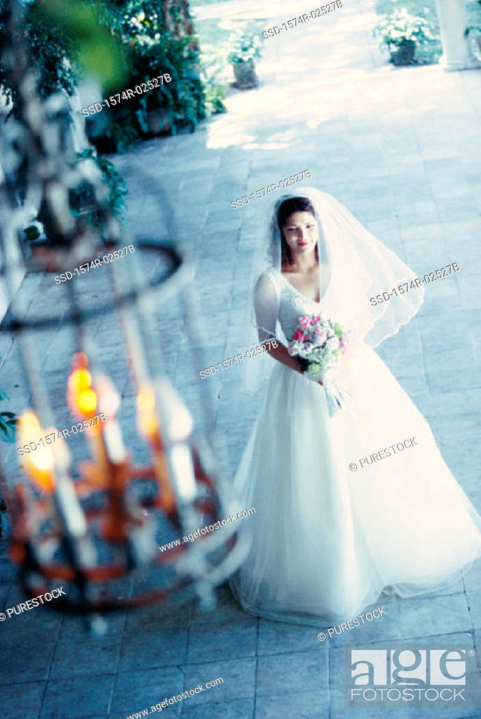 Stock Photo: High angle view of a bride holding a bouquet of flowers.