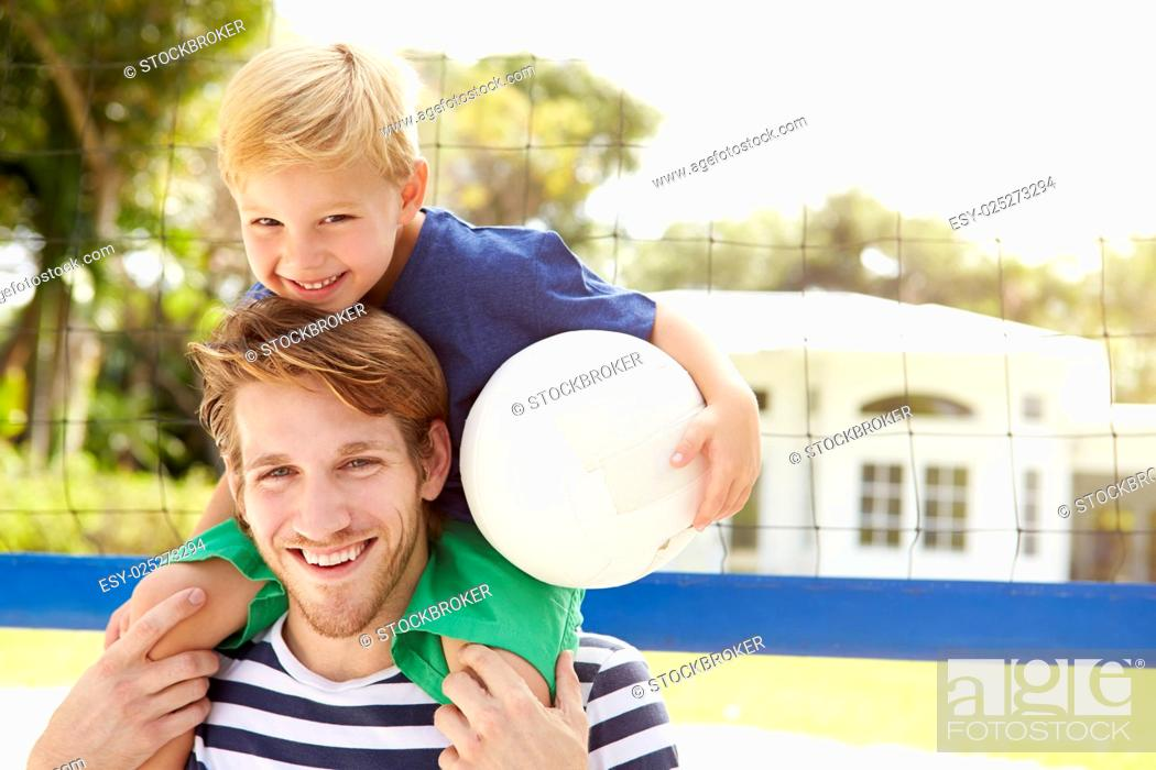Stock Photo: Father And Son Playing Game Of Volleyball In Garden.