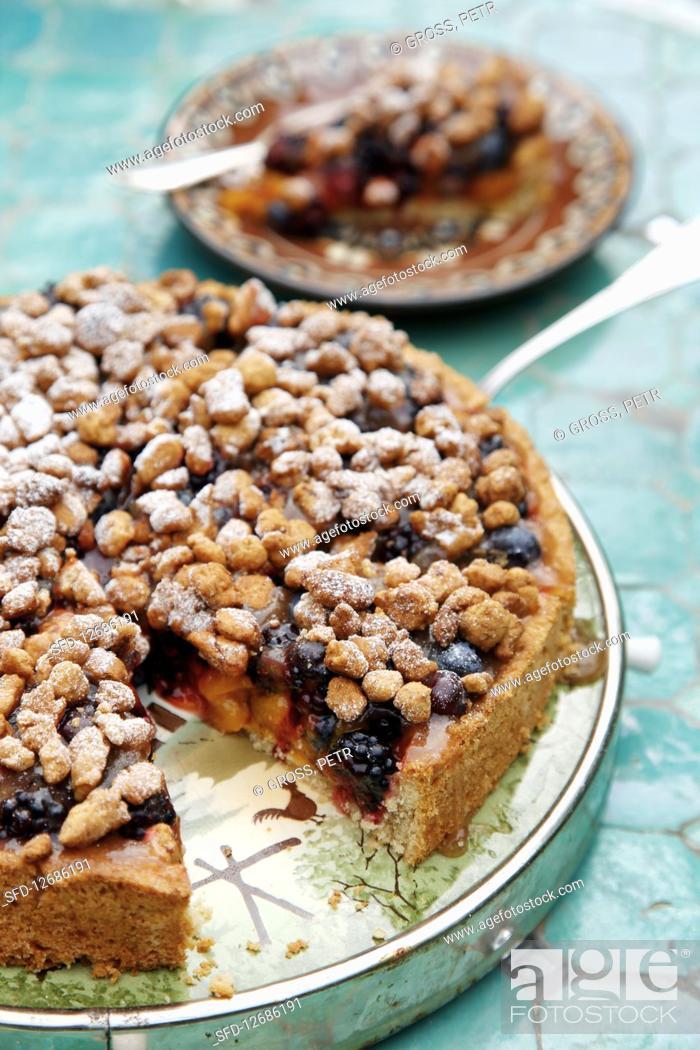 Photo de stock: Blackberry and blueberry cake, sliced.